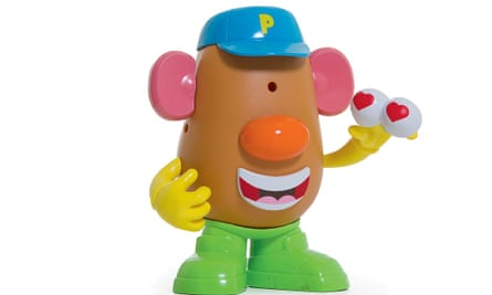 Mr Potato Head, holding a pair of eyeballs with hearts on them, clearly feeling self-love.