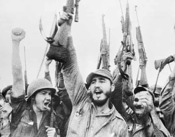 Cuban revolutionary leader Fidel Castro leads his men in 1957.
