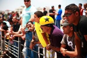 Spectators at a motorsport event in Palestine