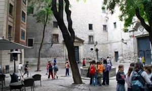 Children playing football at Placa de Sant Filip, Barcelona, Spain