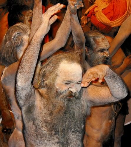 An Indian Sadhu (holy man) covered in ash celebrates the 2003 Kumbh Mela in Nashik.