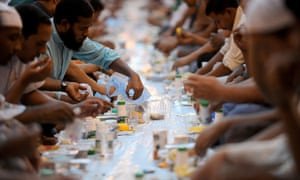 Foreign workers break their fast outside the Imam Turki bin Abdullah mosque in the Saudi capital Riyadh during Islam's holy month of Ramadan on August 7, 2012 . AFP PHOTO/FAYEZ NURELDINEFAYEZ NURELDINE/AFP/GettyImagesHORIZONTAL