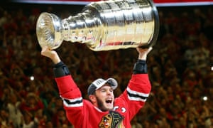 Jonathan Toews of the Chicago Blackhawks celebrates by hoisting the Stanley Cup after defeating the Tampa Bay Lightning  by a score of 2-0 in Game Six to win the 2015 NHL Stanley Cup Final.