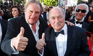 Gerard Depardieu, Sepp Blatter and two photobombers on the red carpet for United Passions at Cannes last year.