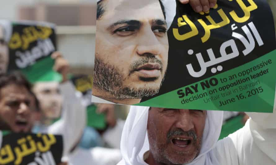 Bahraini Shia Muslims chant slogans during a march in support of prominent jailed opposition leader Sheikh Ali Salman