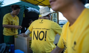 A protester wears a T-shirt against 'fake universal suffrage' in a makeshift tent outside the legislative council in Hong Kong on 15 June.