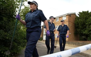 Metropolitan police officers conducting a knife crime investigation in Thornton Heath.