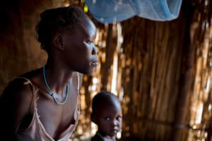 """Ariet Obang, who is 17, and is Married with one baby aged one year,  poses for a photograph as part of a UNICEF photo project to show Girls Empowerment in the village of Awol, near Gambella Ethiopia Friday, Feb. 27, 2015""""I enjoy school and it is very important for me that my child will also go to school and be able to finish school before she has a child"""" she says. The project aims to document the hopes, dreams and aspirations of Ethiopian girls in different parts of the country."""