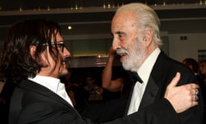 Good friends … Johnny Depp and Christopher Lee greet each other at the premiere of Alice In Wonderland in 2010.