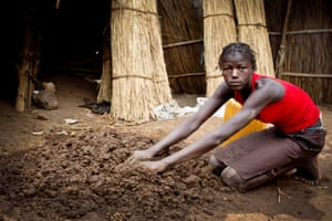 """Ajulu Peter, who is 13 years old, poses for a photograh at her home in the town of Itang, Gambella in, Ethiopia Friday, Feb. 27, 2015. """"It is hard for my family to get support without my father who is now dead,  to help, we can not get the money we need to get many things like exercise books for school"""" she says. AJulu is being photographed  as part of a UNICEF photo project to show Girls Empowerment"""