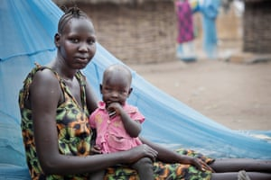 """Nyabuay Bol, 17 years old, and who has 2 children ages 3 years old and 10 months poses for a photograph with her youngest child at her home in Itang, Gambella, Ethiopia Friday, Feb. 27, 2015. She says: """"When I got married and moved to this village, I could have gone to the 9th grade but my husband would not let me attend school after we got married"""" The project aims to document the hopes, dreams and aspirations of Ethiopian girls in different parts of the country."""
