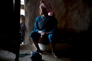 Mestawet Abey, who is 15 years, old,  poses for a photograph in her home,  as part of a UNICEF photo project to show Girls Empowerment in the village of Addis Ge, near Fiche, Ethiopia Saturday, Feb. 21, 2015. Mestawet got married when she was 13, She was forced to drop out of school by her parents to look after their cows and shortly afterwards got married. T