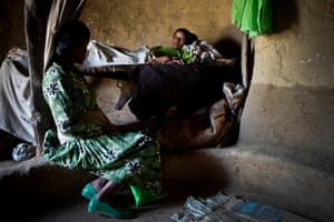 Gurdo Shenqut, 14 years old, lies in bed after giving birth to her first child in her mothers house in the vvillage of Addis Ge, near Fiche, Ethiopia Saturday, Feb. 21, 2015. Gurdo was married at the age of 11 to a man she hardly knew, and was forced to give up school, He is unable to look after her and their new baby properly as he is too poor so she is staying with her mother. She is also increasingly scared of him becuase he beats her when he gets angry.