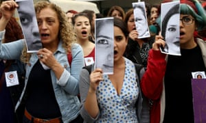 Turkish women at a demonstration in Ankara display photographs of Özgecan Aslan, a student who was killed while resisting an attempted rape.