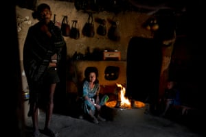 Tensae Belachew, Centre, her husband, Left and her young son, Right, pose for a photograph in their home as part of a UNICEF photo project to show Girls Empowerment in the village of Addis Ge, near Fiche, Ethiopia Saturday, Feb. 21, 2015. Tensae was 13 when she got married and is now 15. She was forced to drop out of school but wishes she could continue.