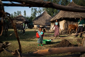 Young girls pose for photographs outside their homes as part of a UNICEF photo project to show Girls Empowerment in the village of  Fiche, Gerar Jarso Woreda, Ethiopia Friday, Feb. 20, 2015.