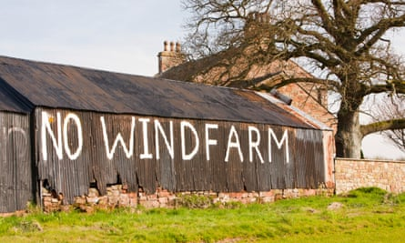 A wind farm protest sign near Carlisle. The UK government is cutting subsidies for new onshore windfarms.