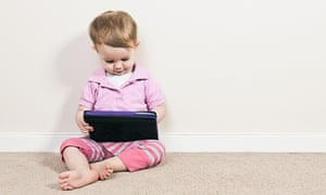 Young girl playing on a tablet computer.