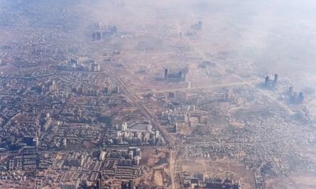 Smog envelops buildings on the outskirts of Delhi.