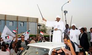 Sudanese president Omar al-Bashir waves to supporters on his return to Khartoum.