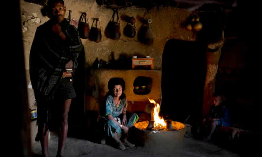 Tensae Belachew, with her husband, left, and her young son, right, in their home in the village of Addis Ge, near Fiche, Ethiopia. Tensae was 13 when she got married.