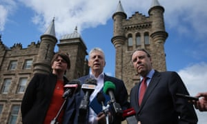 The DUP's Arlene Foster, leader Peter Robinson and Nigel Dodds, in front of Stormont during talks earlier this month on how to save the deal to agree welfare cuts in return for a Treasury loan.