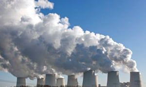 Steam rises from the cooling towers of the Vattenfall coal-fired power plant in Jaenschwalde, Brande