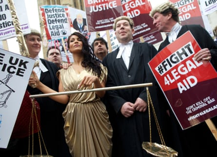 Lawyers stage a walkout and protest against proposed cuts to the legal aid budget in March 2014.