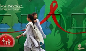 Students in Calcutta walk past the Red Ribbon Express, a train used for an HIV/Aids awareness campaign in India.