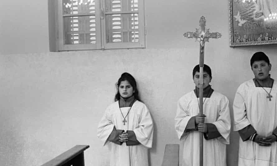 Altar boys and girl serving the Easter mass, near Ajloun, Jordan. (March 2013).
