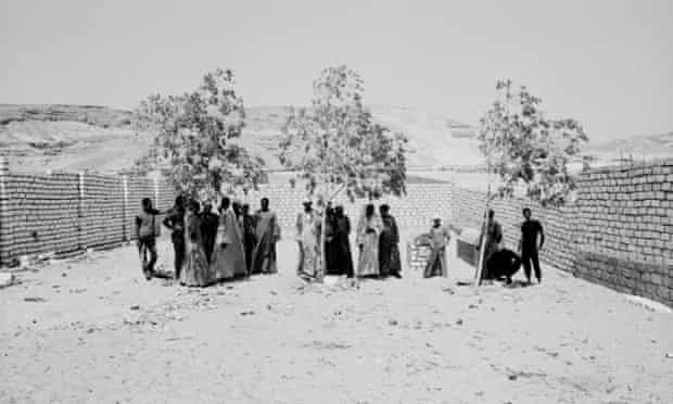 A funeral in Deir Abu Hennis, Egypt, where many of the inhabitants have never left the village (July 2012). Photograph: Davide Di Gianni