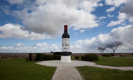 A large model of a wine bottle and vineyards near St Julien, Bordeaux.