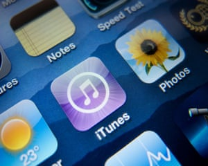 Close-up of screen of iPhone 4G smartphone showing iTunes music app.