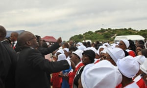 Mourners sing at a Khayelitsha funeral.
