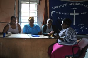 Noluthando Kapa (second left) and friends in Khayelitsha reminisce about home.