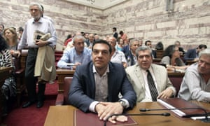 Alexis Tsipras with MPs at the Greek Parliament in Athens.