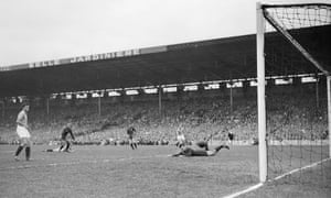 The french keeper can only look at the ball as it flies past him and towards the goal.