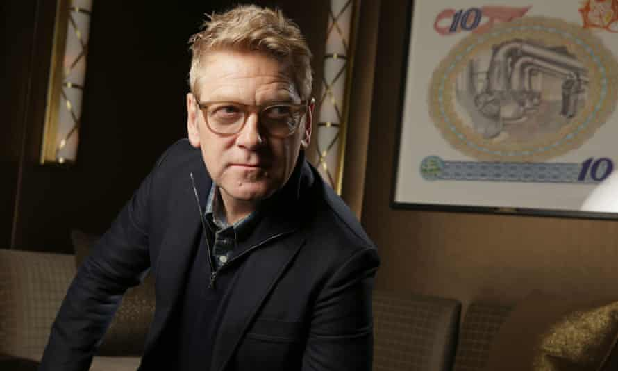 Kenneth Branagh in Beverley Hills in 2013 …on the wall behind appears to be a picture by Eric Ravilious, whose most famous painting, Train Landscape, shows a railway carriage.