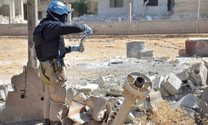A UN weapons inspector appears to collect samples in Syria, 2013.