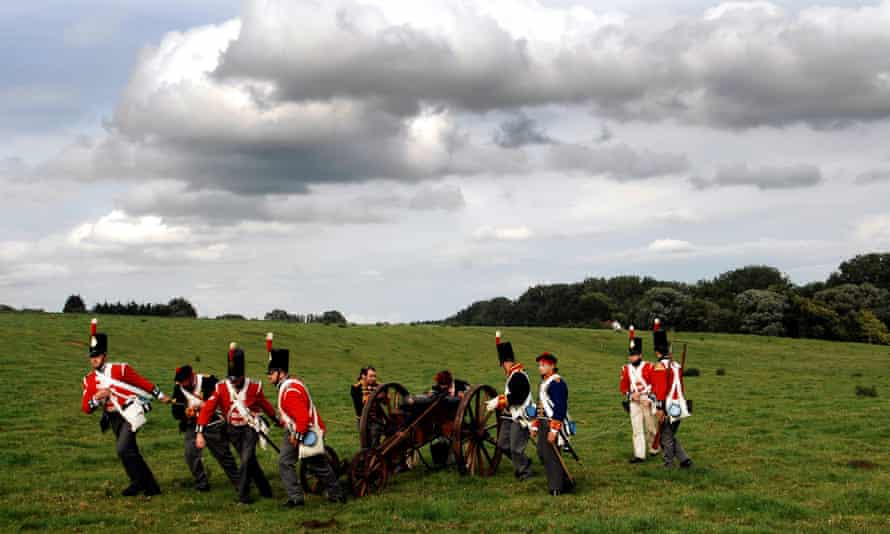 Actors dressed as soldiers pull a cannon during a re-enactment of the Battle of Waterloo near Waterloo, Belgium.