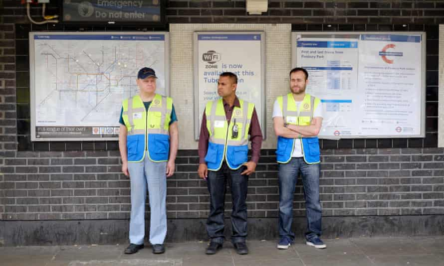 Business and Community Wardens Roger Smith (left), Yilmaz Dursan (right) and supervisor Mohammed Haque (centre) stand around in Finsbury Park, London on Friday, June 12, 2015.  The government's community work placement is intended to give long time unemployed people work experience. However, they say they are standing around for 30 hours a week and get no experience, cannot pay for food and receive no help with applying for jobs.Photograph:    Frantzesco Kangaris