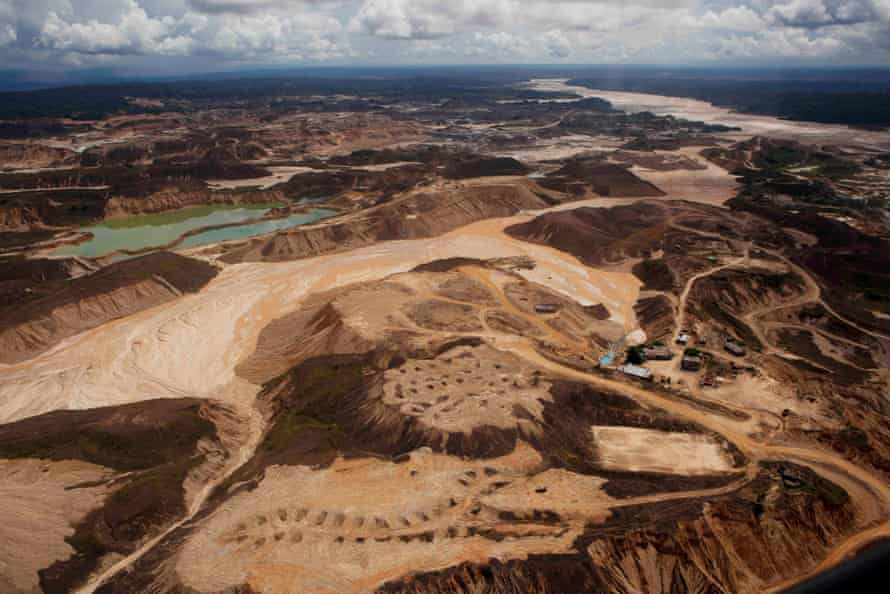 An aerial photo shows the scope of illegal mining in Huepetuhe district  in Peru's Madre de Dios region in Peru, Monday, April 28, 2014. The mining uses tons of mercury and has ravaged forests and poisoned rivers. Authorities began enforcing a ban on illegal mining in the Huepetuhe district. They had given the state s illegal miners until April 19 to get legal or halt operations.
