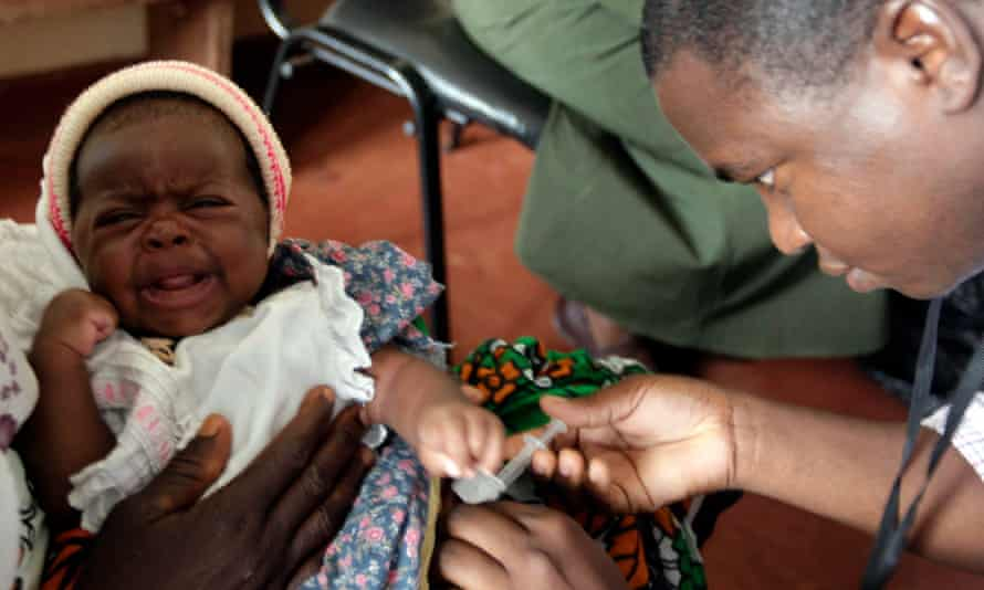 A child is given an injection as part of a malaria vaccine trial