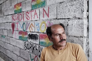Syrian refugee Ahmad Khalif supports other refugees who arrive at Darashakran refugee camp, Iraq