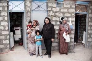 The district mayor of Darashakran, Jawan Rafiq Fathullu, meets refugees arriving in her community.
