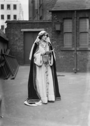 A Suffragette in historic costume at the Green, White & Gold Fair organised by the Women's Freedom League, 1909