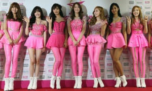 South Korean K-pop girl group Girls' Generation pose for photographers during a news conference for their world tour in Seoul, South Korea.