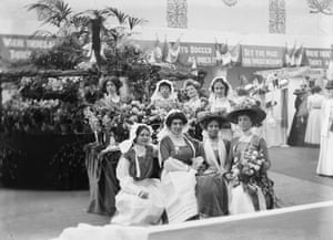 The Suffragette leader Emmeline Pankhurst, (front row, third from left), at the flower stall of the Women's Exhibition, Knightsbridge, May 1909