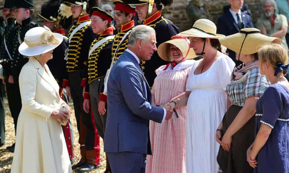 Charles, Prince of Wales, and his wife Camilla, Duchess of Cornwall, greet re-enactors as they attend the ceremonial opening of Hougoumont Farm in Braine-l'Alleud, near Waterloo, Belgium.