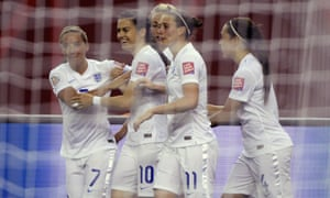 England's Karen Carney, second left, receives her team-mates's congratulations after she opened the scoring.